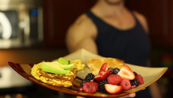 A man offers a healthy breakfast option.