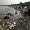 Volunteers collect garbage along the shore off Manila Bay, during an environmental project marking World Oceans Day in Paranaque, Metro Manila.