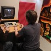 Gamers check out a vintage console at a museum in Berlin