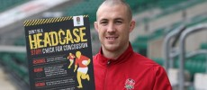Mike Brown, the England fullback, is seen supporting the RFU's latest concussion awareness initiative with a promotional poster.